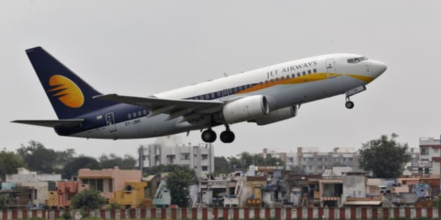 A Jet Airways passenger aircraft takes off from the airport in the western Indian city of Ahmedabad August 12, 2013. Jet recently won a key regulatory approval for its deal to sell a 24 percent stake to Etihad for $379 million, which will be the biggest foreign investment in the Indian civil aviation sector after ownership rules were relaxed. The companies, which need some more approvals, are yet to close the deal. REUTERS/Amit Dave (INDIA - Tags: TRANSPORT BUSINESS)