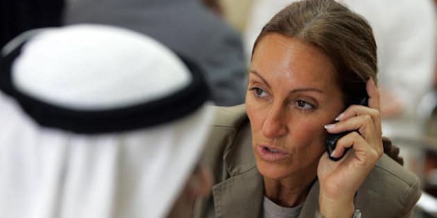 Veronique Robert, mother of a 15-year-old French-Swiss boy, speaks on the phone prior to the start of the trial of an Emirati minor accused of raping her son at the Dubai Juvenile Court, 13 November 2007. Three Emirati men including the minor are accused of raping the French-Swiss boy in July. AFP PHOTO/KARIM SAHIB (Photo credit should read KARIM SAHIB/AFP/Getty Images)