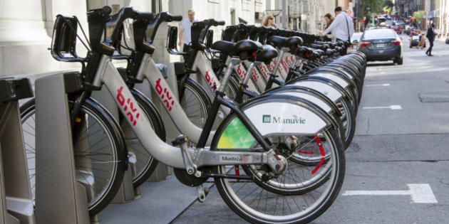Montreal, Quebec, Canada - 18 July 2016 - Shared bikes are lined up in the streets. First large-scale in North America city public bicycle sharing system Bixi. Bicycles in bike dock as editorial