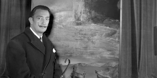 Spanish surrealist painter, Salvador Dali, with his painting 'Christ of Saint John of the Cross'