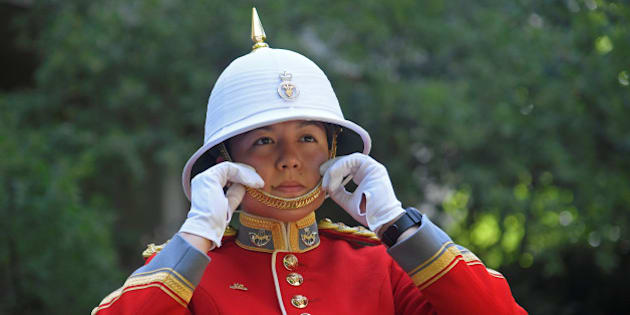 Captain Megan Couto of the 2nd Battalion, Princess Patricia's Canadian Light Infantry, poses for  a photograph as she prepares to command the Queen's Guard, during the Changing of the Guard ceremony, to become the first female officer to do so, at Wellington Barracks, in London, Britain June 26, 2017. REUTERS/Toby Melville