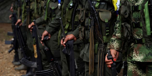 "FARC members stand during a formation in a camp before moving to the transitional zone of Pueblo Nuevo, at the Los Robles FARC camp, Colombia, January 25, 2017. REUTERS/Federico Rios         SEARCH ""FARC FEDERICO"" FOR THIS STORY. SEARCH ""WIDER IMAGE"" FOR ALL STORIES."