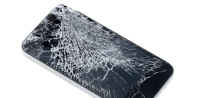 Modern mobile smartphone with broken screen isolated on white background.