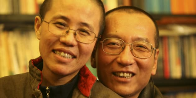 Chinese dissident Liu Xiaobo and his wife Liu Xia pose in this undated photo released by his family on October 3, 2010. Imprisoned Chinese pro-democracy activist Liu Xiaobo won the Nobel Peace Prize on October 8, 2010, an announcement that Beijing had anticipated and bitterly criticised. REUTERS/Handout (CHINA - Tags: POLITICS) FOR EDITORIAL USE ONLY. NOT FOR SALE FOR MARKETING OR ADVERTISING CAMPAIGNS. THIS IMAGE HAS BEEN SUPPLIED BY A THIRD PARTY. IT IS DISTRIBUTED, EXACTLY AS RECEIVED BY REUTERS, AS A SERVICE TO CLIENTS