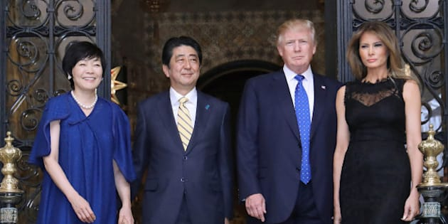 US President Donald Trump (centre R), Japans Prime Minister Shinzo Abe (centre L), Trump's wife Melania (R) and Abe's wife Akie (L) pose for photograpers before a dinner party in Palm Beach, Florida on February 11, 2017. / AFP / JIJI PRESS / STR / Japan OUT        (Photo credit should read STR/AFP/Getty Images)