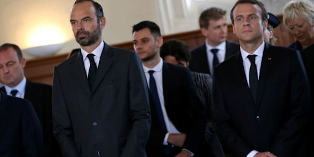 French Prime Minister Edouard Philippe (L) and French President Emmanuel Macron attend a mass to pay tribute to French priest Father Jacques Hamel one year after he was killed by Islamist militants in an attack in the church, in Saint-Etienne-du-Rouvray near Rouen, France, July 26, 2017.   REUTERS/Charly Triballeau/Pool
