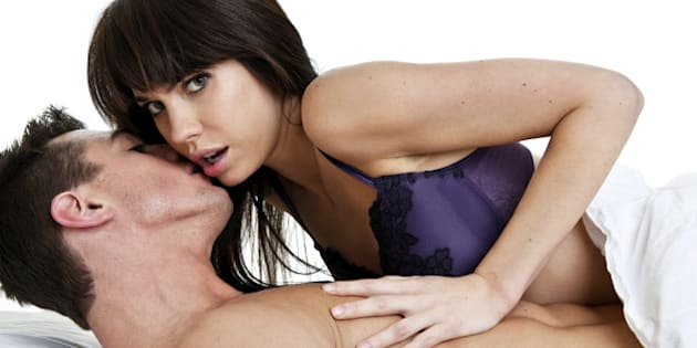 Man whispering in woman's ear woman pushing him away