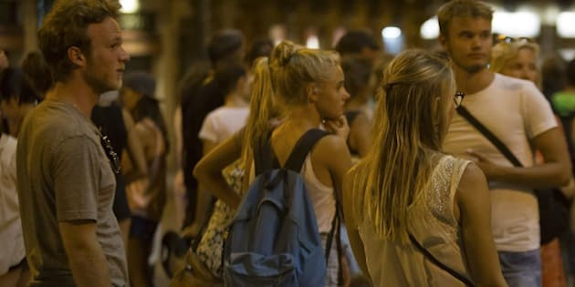 BARCELONA, SPAIN - AUGUST 17: People gather at the scene after a van plowed into the crowd, injuring several people in Barcelona, Spain on August 17, 2017. (Photo by Albert Llop/Anadolu Agency/Getty Images)