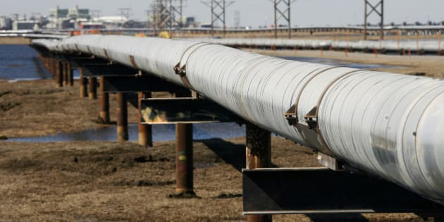 FILE - In this 2007 file photo, a new oil transit pipeline runs across the tundra to flow station at the Prudhoe Bay oil field on Alaska's North Slope. The oil pipeline that stretches 800 miles across the Alaska landscape is celebrating a milestone. The trans-Alaska oil pipeline on Wednesday marked 35 years in production with more than 16.5 billion barrels of oil loaded into the pipeline at Prudhoe Bay for delivery to Valdez, where it is loaded intotankers destined for the West Coast. (AP Photo/Al Grillo, File)