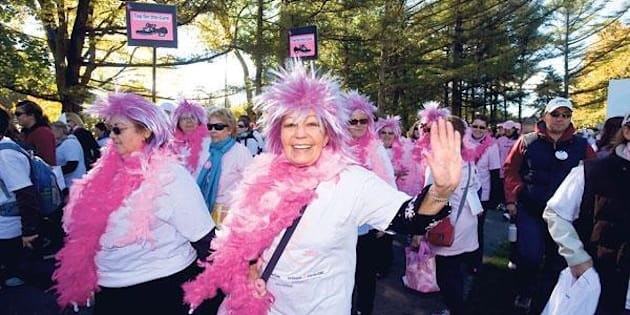Thousands of people wearing a pink t-shirt participates in the 'The Young Ladies of Bugatti' race against breast cancer on October 23, 2011 at the Le Mans' racetrack, western France.  AFP PHOTO / JEAN FRANCOIS MONIER (Photo credit should read JEAN-FRANCOIS MONIER/AFP/Getty Images)