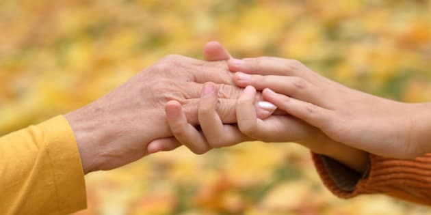 hands of people of different...