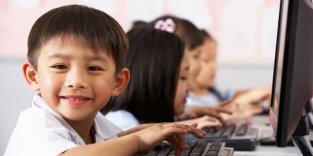 male pupil using keyboard...