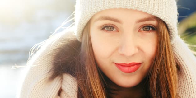 beautiful young woman winter...