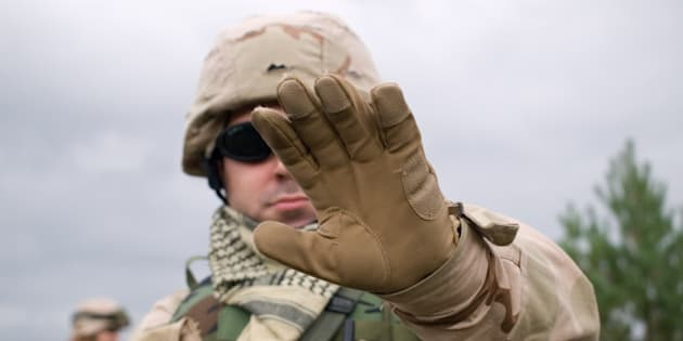 the us soldier showing arm to...