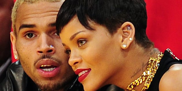 Rihanna (R) and Chris Brown attend a game between the New York Knicks and the Los Angeles Lakers during the NBA game at Staples Center in Los Angeles, California, on December 25, 2012. AFP PHOTO / Robyn Beck        (Photo credit should read ROBYN BECK/AFP/Getty Images)