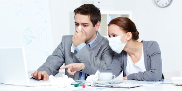image of sick businessman with...