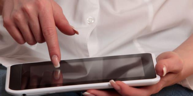 woman using digital tablet...
