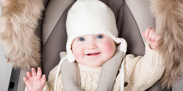 funny little baby in a warm hat ...