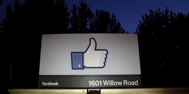 The sun rises behind the entrance sign to Facebook headquarters in 2012 in this file photo. Facebook announced a suite of new tools Wednesday to combat revenge porn on the site.