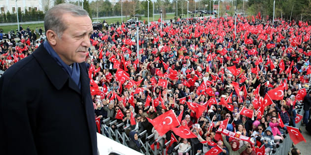 Erdogan greets the crowd, who were waiting to celebrate the results of the referendum, after he arrived in the Esenboga International Airport in Ankara, Turkey on April 17.