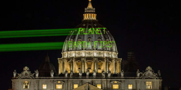A few hours before the meeting between Pope Francis and President Donald Trump, Greenpeace activists send a message on the dome of St. Peter's Basilica early Wednesday.
