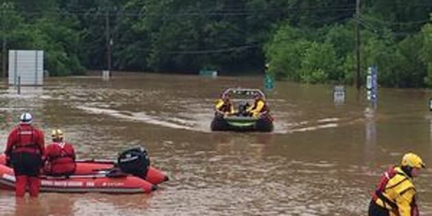 Emergency crews take out boats on a flooded I-79 at the Clendenin Exit, after the state was pummeled by up to 10 inches of rain on Thursday, causing rivers and streams to overflow into neighboring communities, in Kanawha County, West Virginia, June 24, 2016.  West Virginia Department of Transportation/Handout via Reuters  ATTENTION EDITORS - THIS IMAGE WAS PROVIDED BY A THIRD PARTY. EDITORIAL USE ONLY