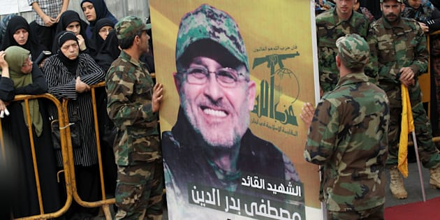 Hezbollah members carry a portrait of to commander Mustafa Badreddine during his funeral in Beirut on Friday. The Lebanese Shi'ite movement blamed hardline Sunni rebels for his death in Syria.