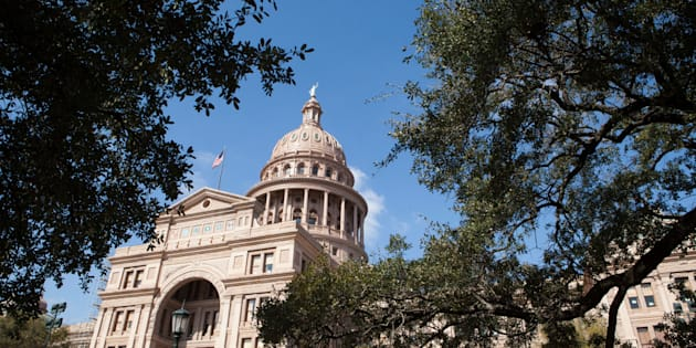 AUSTIN, TEXAS - FEBRUARY 22: The Texas State Capitol is seen through the trees, on February 22, 2016 in Austin, Texas. The Capitol, completed in 1888 in downtown Austin, contains the offices and chambers of the Texas Legislature and the Office of the Governor. The Texas Legislature passed a restrictive abortion bill, HB2. The US Supreme Court will rule on whether to overturn or uphold the bill. (Photo by Melanie Stetson Freeman/The Christian Science Monitor via Getty Images)