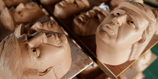 TheJinhua Partytime Latex Art and Crafts Factory is churning out masks of presidential candidates Hillary Clinton and Donald Trump.