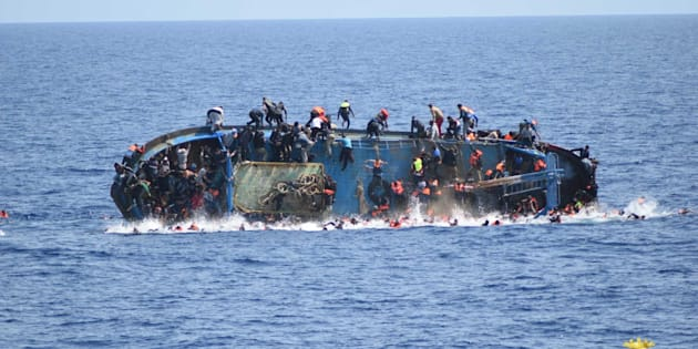 An overcrowded migrant boat shortly before capsizing in the Mediterranean Sea between Libya and Italy on Wednesday. The Italian navy rescued over 500 passengers but several drowned.