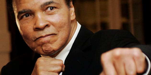 U.S. boxing great Muhammad Ali poses during the Crystal Award ceremony at the World Economic Forum (WEF) in Davos, Switzerland January 28, 2006. REUTERS/Andreas Meier/File Photo