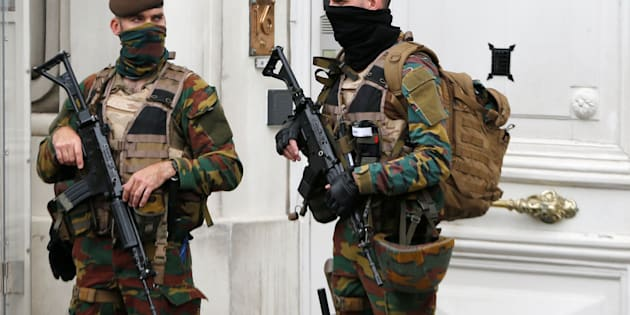 Belgian police arrested 12 suspects in a major anti-terror operation overnight. Above, Belgian soldiers stand guard outside the prime minister's office.