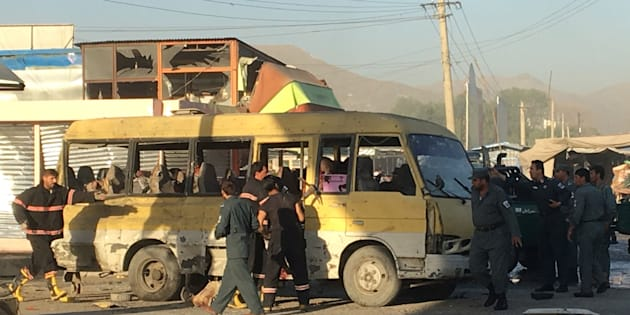 Police and fire fighters are seen at the site of a blast in Kabul on Monday.