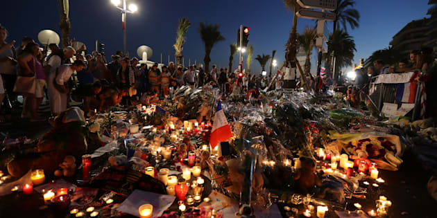 Crowds gather at a make-shift memorial for victims of the deadly Bastille Day attack on the Promenade des Anglais in Nice on July 16, 2016.   The Islamic State group claimed responsibility for the truck attack that killed 84 people in Nice on France's national holiday, a news service affiliated with the jihadists said on July 16. Tunisian Mohamed Lahouaiej-Bouhlel, 31, smashed a 19-tonne truck into a packed crowd of people in the Riviera city celebrating Bastille Day -- France's national day. / AFP / Valery HACHE        (Photo credit should read VALERY HACHE/AFP/Getty Images)