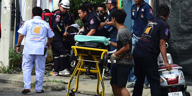Thai rescue workers attend to an injured victim after a bomb exploded in Hua Hin, south of Bangkok