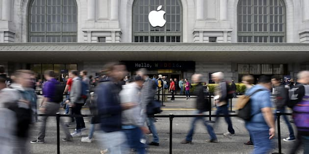 Attendees enter the Bill Graham Civic Auditorium for the Apple World Wide Developers Conference (WWDC) in San Francisco, California, U.S., on Monday, June 13, 2016. Apple Inc. has lost ground to Alphabet Inc.'s Google in the hot voice-activated assistant space. By releasing a software kit at today's Worldwide Developers Conference that lets programmers integrate Siri into their apps, it hopes to catch up with the maker of Google Now and the Android operating system -- as well as Amazon.com Inc.'s Alexa virtual helper -- and thus tie customers more closely to its iOS system. Photographer: Michael Short/Bloomberg via Getty Images