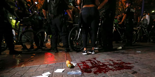 Blood covers the pavement where a person was shot in uptown Charlotte, NC during a protest of the police shooting of Keith Scott, in Charlotte, North Carolina, U.S. September 21, 2016. REUTERS/Jason Miczek