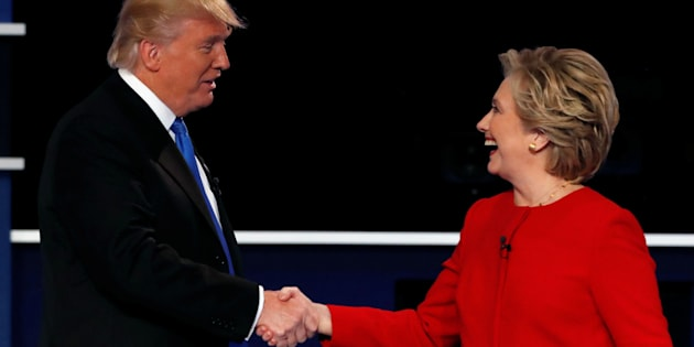 Republican U.S. presidential nominee Donald Trump and Democratic U.S. presidential nominee Hillary Clinton shake hands.