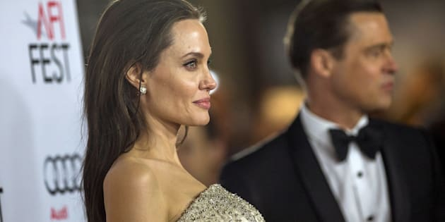 """Director and cast member Angelina Jolie and her husband and co-star Brad Pitt pose at the premiere of """"By the Sea"""" during the opening night of AFI FEST 2015 in Hollywood, California November 5, 2015. The movie opens in the U.S. on November 13.  REUTERS/Mario Anzuoni"""