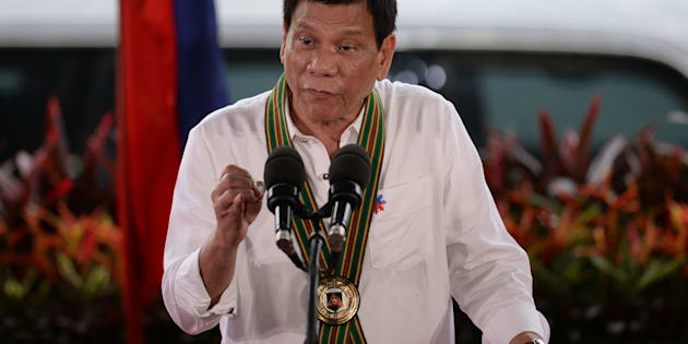 Philippine President Rodrigo Duterte gestures as he delivers a speech during a 'talk to the troops' visit to meet military personnel in Manila on October 4, 2016. Rodrigo Duterte launched a fresh tirade at the United States on October 4, telling Barack Obama to 'go to hell' as the longtime allies launched war games that the firebrand Philippine leader warned could be their last. / AFP / TED ALJIBE        (Photo credit should read TED ALJIBE/AFP/Getty Images)