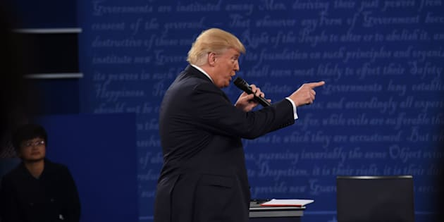 US Republican presidential candidate Donald Trump debates during the second presidential debate at Washington University in St. Louis, Missouri, on October 9, 2016. / AFP / Robyn Beck        (Photo credit should read ROBYN BECK/AFP/Getty Images)