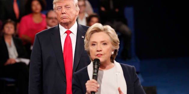 Republican U.S. presidential nominee Donald Trump listens as Democratic nominee Hillary Clinton answers a question from the audience during their presidential town hall debate at Washington University in St. Louis, Missouri, U.S., October 9, 2016. REUTERS/Rick Wilking