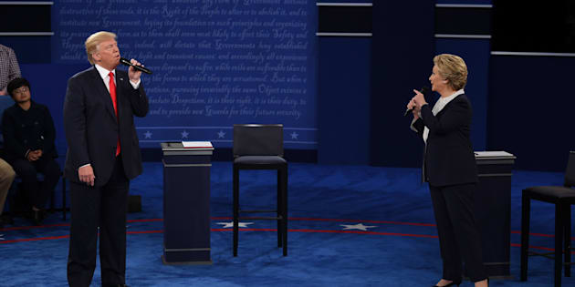 US Democratic presidential candidate Hillary Clinton (R) and US Republican presidential candidate Donald Trump debate during the second presidential debate at Washington University in St. Louis, Missouri, on October 9, 2016. / AFP / Robyn Beck        (Photo credit should read ROBYN BECK/AFP/Getty Images)