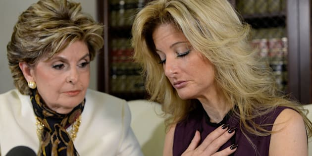 Summer Zervos, a former contestant on the TV show The Apprentice, reacts next to lawyer Gloria Allred (L) while speaking about allegations of sexual misconduct against Donald Trump during a news conference in Los Angeles, California, U.S. October 14, 2016.  REUTERS/Kevork Djansezian