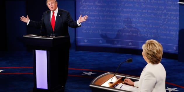 LAS VEGAS, NV - OCTOBER 19:  Republican presidential nominee Donald Trump (L) speaks as Democratic presidential nominee former Secretary of State Hillary Clinton looks on during the third U.S. presidential debate at the Thomas & Mack Center on October 19, 2016 in Las Vegas, Nevada. Tonight is the final debate ahead of Election Day on November 8.  (Photo by Pool/Getty Images)