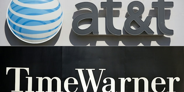 (COMBO) This combination of pictures created on October 21, 2016 shows AT&T cellphone store in Springfield, Virginia, on October 23, 2014. And the Time Warner company logo on the front of the headquarter building, 24 November, 2003, in New York.  AT&T is in 'advanced talks' to acquire entertainment group Time Warner in a move to add in-house content to distribution services, The Wall Street Journal reported on October 21, 2016.    AT&T could seal the deal 'as early as this weekend,' the Journal said, citing people familiar with the matter.   / AFP / SAUL LOEB AND STAN HONDA        (Photo credit should read SAUL LOEB,STAN HONDA/AFP/Getty Images)