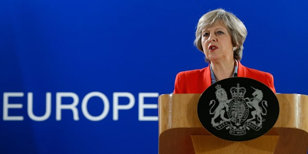 British Prime Minister Theresa May answers a question from the media during the final press briefing at the EU Summit in Brussels, Friday, Oct. 21, 2016. Britains prime minister vowed on Thursday that the U.K. would continue to exert it full rights in the workings of the European Union until it leaves the 28-nation bloc. (AP Photo/Alastair Grant)