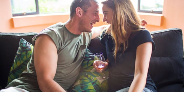 Young couple drinking laughing and having a good time