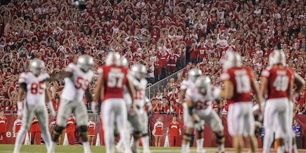 15 October 2016: Wisconsin Badger students in section O put their hands in in the shape of an O before the snap of a ball as the 2nd ranked Ohio State Buckeyes defeat the 8th ranked Wisconsin Badgers (30-23) in overtime at Camp Randall Stadium in Madison, WI. (Photo by Dan Sanger/Icon Sportswire via Getty Images)