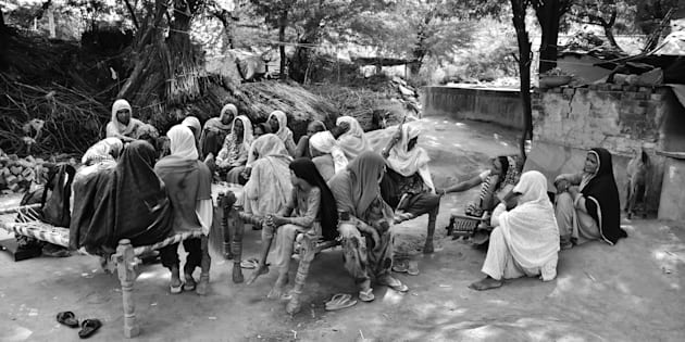 The women of Kherla village in northern India gather to listen to their favorite radio program on Radio Mewat The community radio station airs discussions and advice on health education and finance to the villagers in isolated and impoverished Mewat district